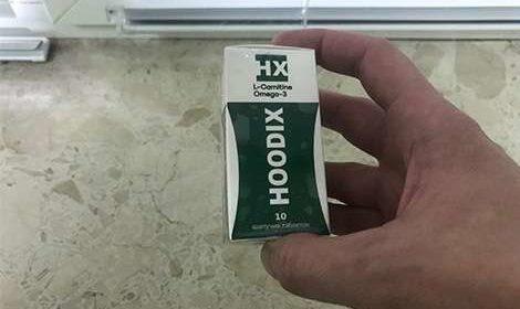 Внешний вид таблеток hoodix в руках