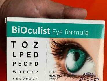 . Упаковка лекарства Биокулист в руке крупным планом.